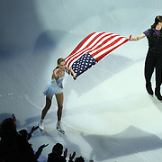 Polina Edmunds and Jason Brown skate with an American Flag during the Smucker's Skating Spectacular at the TD Garden on January 12, 2014 in Boston, Massachusetts.