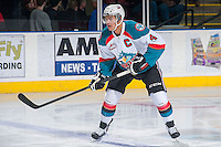 KELOWNA, CANADA -FEBRUARY 25: Madison Bowey #4 of the Kelowna Rockets looks for the pass against the Prince George Cougars on February 25, 2014 at Prospera Place in Kelowna, British Columbia, Canada.   (Photo by Marissa Baecker/Getty Images)  *** Local Caption *** Madison Bowey;