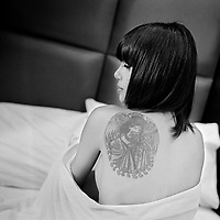 Bangkok, february 2010, Wong-manee, a 21-year-old Thai woman, displays a tattoo on her back.