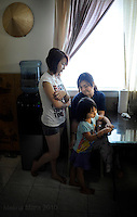 NEW ORLEANS, LA- June 22:  A close family, Cathy Nguyen, 13, Lisa Nguyen, 20, and Christine Nguyen, 3, hangout after lunch... The Nguyens', a Vietnamese fishing family, at home in east New Orleans, New Orleans, Louisiana, Tuesday June 22, 2010.  Dung Nguyen, the father, has been unable to work on the shrimp boat  since the spill, and has had to apply for assistance and train for oil spill clean up work. (Melina Mara/The Washington Post)