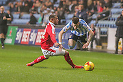 Barnsley defender Reece Wabara  fouls Coventry City midfielder, on loan from Liverpool, Ryan Kent   during the Sky Bet League 1 match between Coventry City and Barnsley at the Ricoh Arena, Coventry, England on 3 November 2015. Photo by Simon Davies.