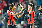 Winning goal scorer Nathan Ake of AFC Bournemouth celebrates the 4-3 win over Liverpool at full time with AFC Bournemouth defender Adam Smith during the Premier League match between Bournemouth and Liverpool at the Vitality Stadium, Bournemouth, England on 4 December 2016. Photo by Graham Hunt.