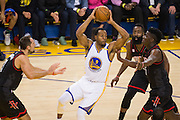 Houston Rockets defense surrounds Golden State Warriors forward Andre Iguodala (9) during the first quarter at Oracle Arena in Oakland, Calif., on December 1, 2016. (Stan Olszewski/Special to S.F. Examiner)