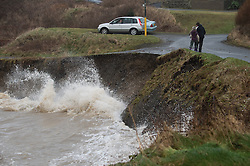 © London News Pictures. Aberystwyth, Wales. 03/01/2014. A small landslide on the coast as A 5.6m high springtide and gale force south westerly winds bring  massive weaves pounding against the promenade and harbour at Aberystwyth on the west wales  coast.  The entire promenade was  closed to traffic because of fears for safety. Over 20 severe warnings have been issued for flooding in England and Wales, with the weather set to worsen over the next 24 hours, Across much off the south and west coast. Photo credit: Keith Morris/LNP