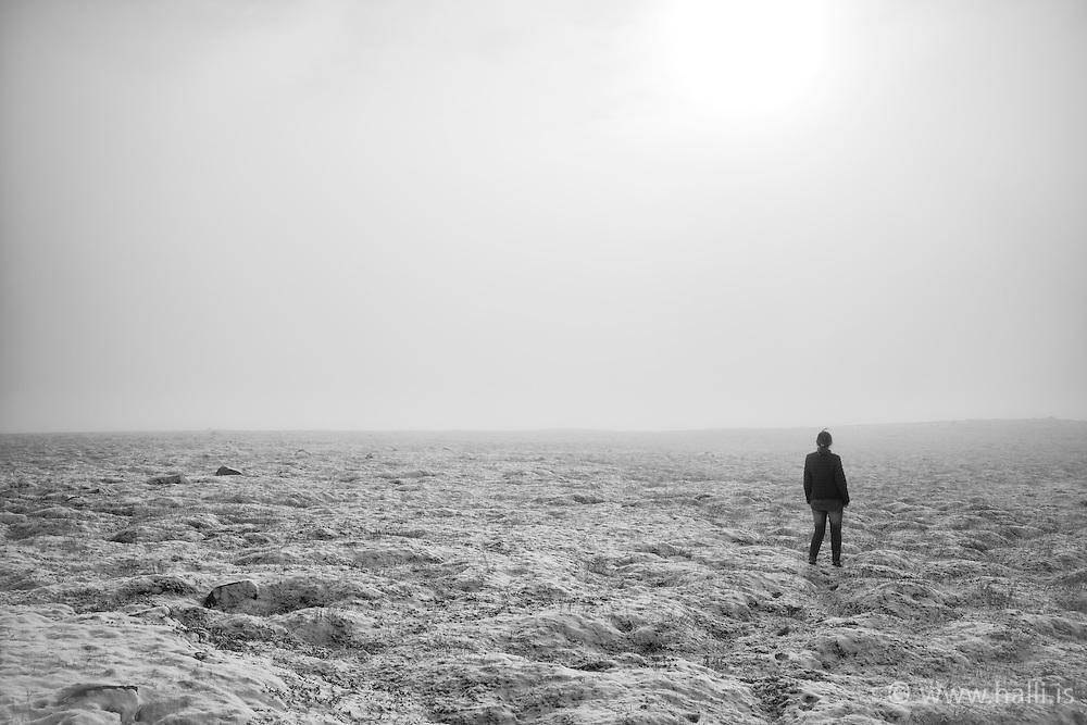 Woman standing in the fog, Hengill area, Iceland - Kona í þoku