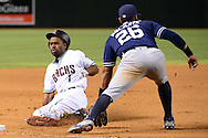 PHOENIX, AZ - JULY 05:  Michael Bourn #1 of the Arizona Diamondbacks safely slides in front of Yangervis Solarte #26 of the San Diego Padres for a triple during the seventh inning at Chase Field on July 5, 2016 in Phoenix, Arizona.  (Photo by Jennifer Stewart/Getty Images)