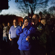 Trump rally supporters pray in the overflow outside listening to candidate Donald Trump speak at the University of Wisconsin, Eau Claire campus, November 1st, 2016