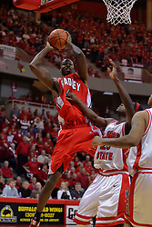 "31 January 2009: David Collins looks at Champ Oguchi as he pulls in a rebound.  The Illinois State University Redbirds join the Bradley Braves in a tie for 2nd place in ""The Valley"" with a 69-65 win on Doug Collins Court inside Redbird Arena on the campus of Illinois State University in Normal Illinois"