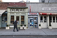 New York. Lower east side. Café Charbon (168 Orchard St. at Stanton Street, 212-420-7520). Its adorable facade, made up to look like an épicerie, a crémerie and a tabac, is the perfect photo op. Inside is just as charming: The walls are lined with French grocery products . in Lower east side trendy area  New York - United states  /  Café Charbon (168 Orchard St. at Stanton Street, 212-420-7520). restaurant francais, avec pour decoration une rue de paris en facade. dans le lower east side quartier branche  New York - Etats-unis