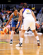 Sep 11, 2011; Phoenix, AZ, USA; Minnesota Lynx guard Candice Wiggins (11) handles the ball against the Phoenix Mercury guard Ketia Swanier (11) during the first half at the US Airways Center.  The Lynx defeated the Mercury 96-90. Mandatory Credit: Jennifer Stewart-US PRESSWIRE