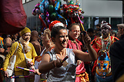 Women beating drumsticks in the parade celebrating the festival of Ganesh Chaturthi, marking the birth of the Hindu god Ganesha, on the streets of the La Chapelle area of the 18th arrondissement of Paris, France, on Sunday 1st September 2019. The annual religious festivities and parade take place near the Ganesha Temple of Paris, or Sri Manicka Vinayakar Alayam Temple, the largest Hindu temple in France. Ganesha is the elephant-headed Hindu God of Beginnings, son of Shiva and Parvati, who represents love and knowledge. Picture by Manuel Cohen