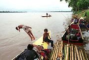 Stung Trang, Cambodia 072904  Children jump into the murky waters of the Mekong river. (Essdras M Suarez/ Globe Staff)