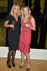 Left to right, VERONIKA TIKHONOVA and NATALIA KYZNETSOUD at a private view and auction of millinery organised by author, philanthropist and hat collector Eva Lanska in aid of Women for Women International held at Pace, Burlington Gardens, London on 10th June 2015.