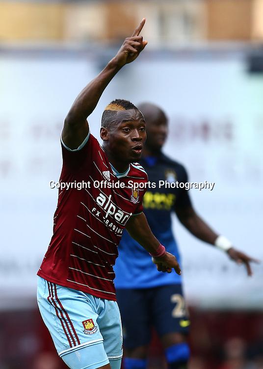 25 October 2014 - Barclays Premier League - West Ham v Manchester City - Diafra Sakho of West Ham celebrates scoring the winning goal - Photo: Marc Atkins / Offside.