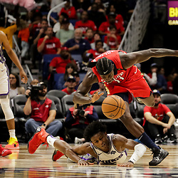 Oct 19, 2018; New Orleans, LA, USA; New Orleans Pelicans guard Jrue Holiday (11) breaks away from Sacramento Kings guard De'Aaron Fox (5) on a loose ball during the second half at the Smoothie King Center. The Pelicans defeated the Kings 149-129. Mandatory Credit: Derick E. Hingle-USA TODAY Sports