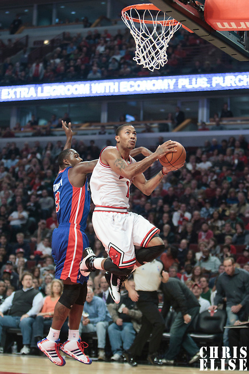 30 October 2010: Chicago Bulls Derrick Rose goes to the basket past Detroit Pistons Rodney Stuckey during the Chicago Bulls 101-91 victory over the Detroit Pistons at the United Center, in Chicago, Illinois, USA.