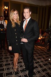 ANNABEL BUCHANAN and TOM BUCHANAN  grandchildren of Nicholas Parsons at the 90th birthday party for Nicholas Parsons held at the Hyatt Churchill Hotel, Portman Square, London on 8th October 2013.
