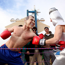 Kyle Green | The Roanoke Times<br /> 2/10/2012 Washington And Lee student Parker Mangold (left, junior), dressed as George Bush punches Andy Roberts (right, freshman), dressed as alcoholism in a boxing ring attached to the back of the Nevada state float participating in the Washington and Lee mock convention parade in downtown, Lexington, Virginia on Friday.