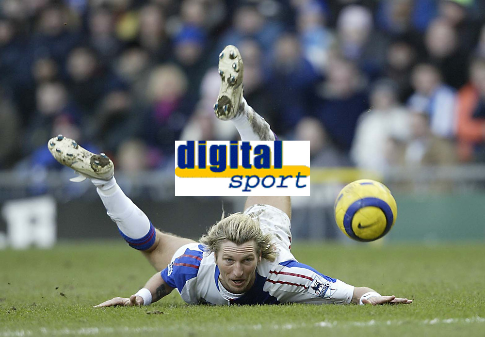 Photo: Aidan Ellis.<br /> Blackburn Rovers v Arsenal. The Barclays Premiership. 25/02/2006.<br /> Blackburn's Robbie Savage makes a back pass to his keeper with this header on the floor