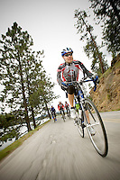 JEROME A. POLLOS/Press..Jeff Fletcher makes his way up toward the Fernan Saddle during a training ride with some friends Wednesday.