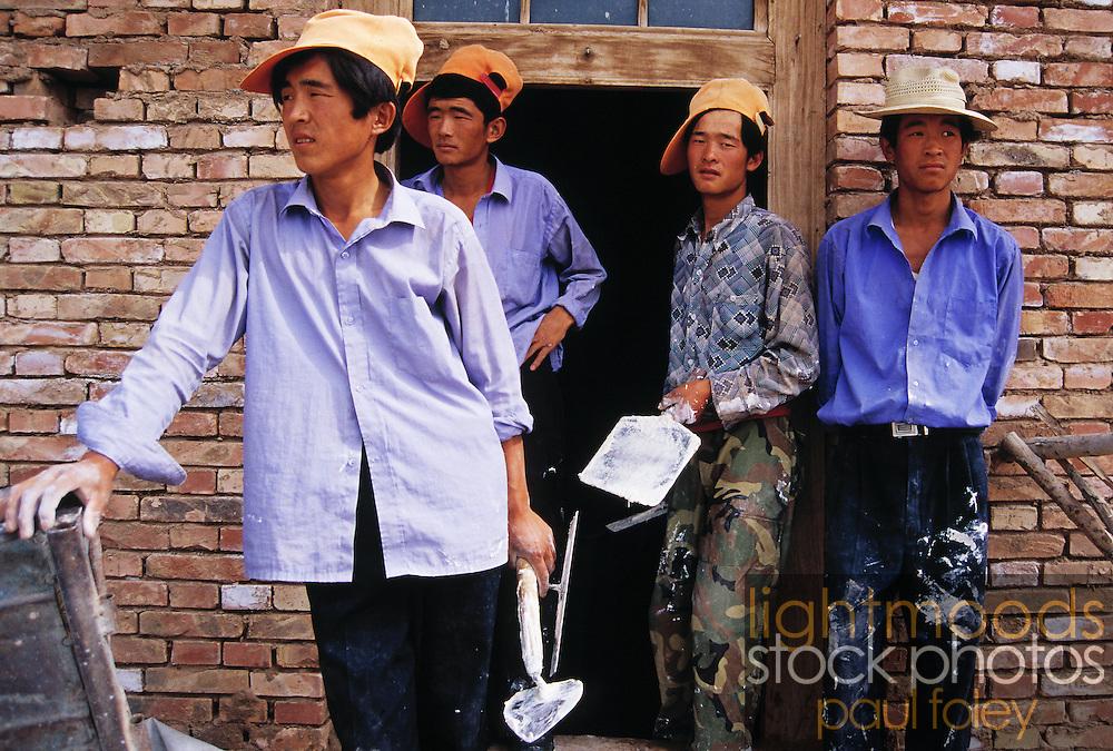 Young plasterers, Guancai village, Ningxia Province, China