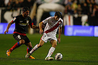 10.02.2013 SPAIN -  La Liga 12/13 Matchday 23th  match played between Rayo Vallecano vs Atletico de Madrid (2-1) at Campo de Vallecas stadium. The picture show Roberto Trashorras (Spanish player of Rayo Vallecano) and Raul Garcia (Spanish midfielder of At. Madrid)
