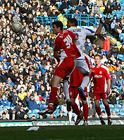 Photo: Steve Bond/Richard Lane Photography. Leeds United v Swindon Town. Coca Cola League One. 14/03/2009. Jermaine Beckford gets above Owain Tudor Jones