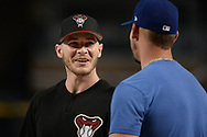 PHOENIX, AZ - AUGUST 10:  Chris Herrmann #10 of the Arizona Diamondbacks talks with Yasmani Grandal #9 of the Los Angeles Dodgers during batting practice for the MLB game at Chase Field on August 10, 2017 in Phoenix, Arizona.  (Photo by Jennifer Stewart/Getty Images)