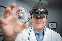 An ophthalmologist performs an eye exam