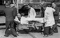 Republican Labour MP, Gerry Fitt, is stretchered to an ambulance after collapsing at Parliament Buildings, Stormont, N Ireland, 4th June 1969. 196906040186a<br /> <br /> Copyright Image from Victor Patterson,<br /> 54 Dorchester Park, <br /> Belfast, UK, BT9 6RJ<br /> <br /> t1: +44 28 9066 1296 (from Rep of Ireland 048 9066 1296)<br /> t2: +44 28 9002 2446 (from Rep of Ireland 048 9002 2446)<br /> <br /> m: +44 7802 353836<br /> <br /> e: victorpatterson@me.com<br /> www.victorpatterson.com<br /> <br /> Please see my Terms and Conditions of Use at www.victorpatterson.com. It is IMPORTANT that you familiarise yourself with them.<br /> <br /> Images used on the Internet must be visibly watermarked i.e. © Victor Patterson<br /> within the body of the image and copyright metadata must not be deleted. Images <br /> used on the Internet have a size restriction of 4kbs and will be chargeable at current<br />  NUJ rates unless agreed otherwise.<br /> <br /> This image is only available for the use of the download recipient i.e. television station, newspaper, magazine, book publisher, etc, and must not be passed on to any third <br /> party. It is also downloaded on condition that each and every usage is notified within 7 days to victorpatterson@me.com<br /> <br /> The right of Victor Patterson to be identified as the author is asserted in accordance with The Copyright Designs And Patents Act (1988). All moral rights are asserted.