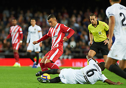 November 3, 2018 - Valencia, Valencia, Spain - Geoffrey Kondobia of Valencia CF and Borja Garcia of Girona FC during the La Liga match between Valencia CF and Girona FC at Mestala Stadium on November 3, 2018 in Valencia, Spain (Credit Image: © AFP7 via ZUMA Wire)