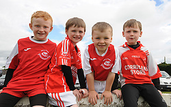 Young Ballintubber supporters Shane Cunningham, Finian Brady, Kyle Nimmo and Cian Brady enjoying the club championship match against Charlestown on saturday evening last.<br />Pic Conor McKeown