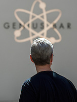 Tim Cook, chief executive officer of Apple Inc., leaves an Apple Inc. store in Palo Alto, California, U.S., on Friday, April 10, 2015. From London to Beijing, Apple stores saw few customers lined up before opening Friday as pre-orders started. The first new gadget under Chief Executive Officer Tim Cook is selling in eight countries and Hong Kong, with shipments scheduled to start April 24. Photographer: David Paul Morris