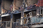 Melted properties and devastated frontages after an inner-city estate fire in south London. About 310 people were forced to leave their homes after the fire engulfed a wooden structure under construction in scaffolding at Sumner Road and Garrisbrooke Estate, Peckham, London at about 0430 AM. It spread to two blocks of maisonettes and a destroyed a pub. More than 150 firefighters tackled this unusually large and ferocious fire which injured ten people, including two police officers who received hospital treatment for minor injuries.  .