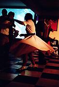 Woman dancing wearing a polka-a-dot dress, Brazil, 2000's