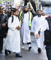 © Licensed to London News Pictures . London , UK . Siddhartha Dhar (L holding a camera) and Anjem Choudary (R) at a Muslims Against Crusades demonstration outside the American Embassy in Grosvenor Square on the tenth anniversary of the 9/11 attacks in London on September 11, 2011. There has been speculation that Siddhartha Dhar is this the new 'Jihadi John', who appeared in a recent ISIS video . Photo credit : Joel Goodman/LNP