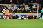 Hull City midfielder Jon Toral (11) and Barnsley FC defender Adam Jackson (18) are injured during the EFL Sky Bet Championship match between Hull City and Barnsley at the KCOM Stadium, Kingston upon Hull, England on 27 February 2018. Picture by Ian Lyall.
