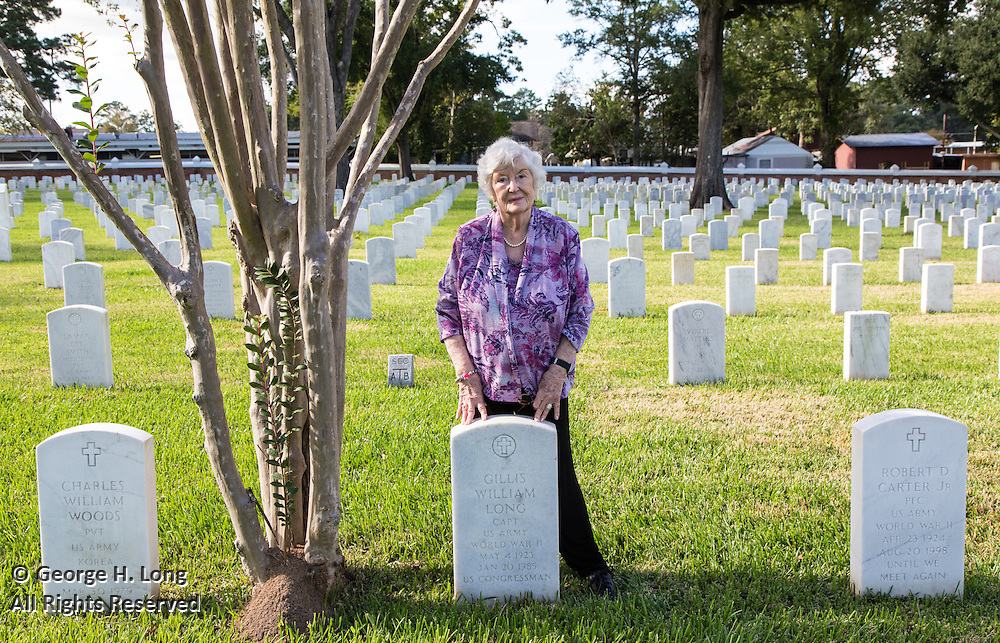 Cathy Long stands by the grave of her husband, former Congressman Gillis Long, in Alexandria National Cemetery, Pineville, Louisiana