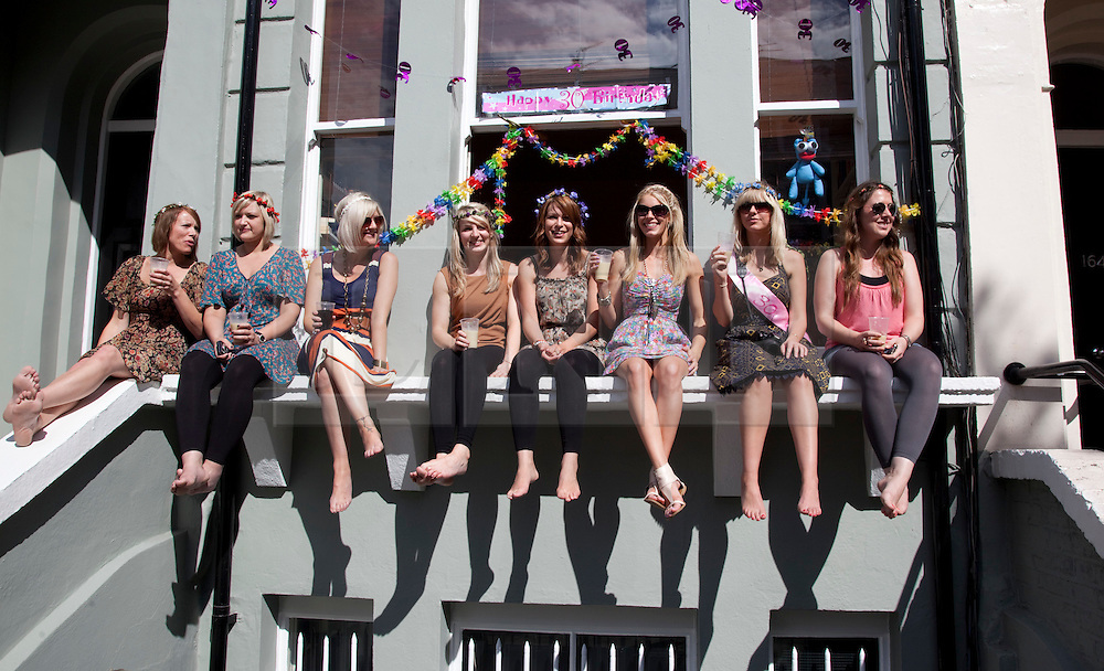 © Licensed to London News Pictures. 28/08/2011. London, England. Notting Hill Carnival 2011, Children's Day. Residents haveing a party. Photo credit: Bettina Strenske/LNP
