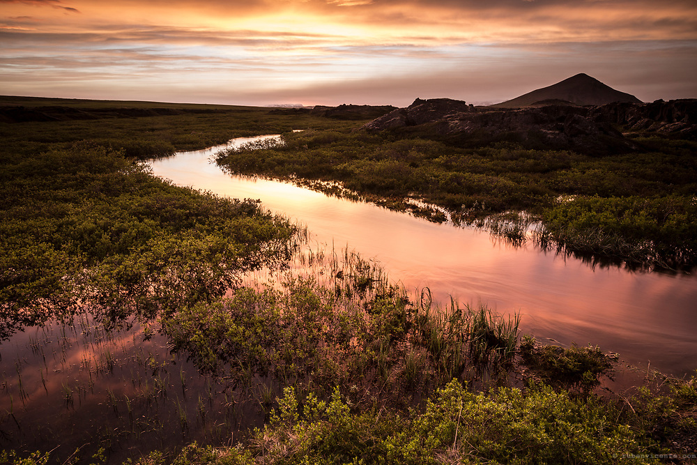 Sunset reflected in a stream. Myvatn, Iceland