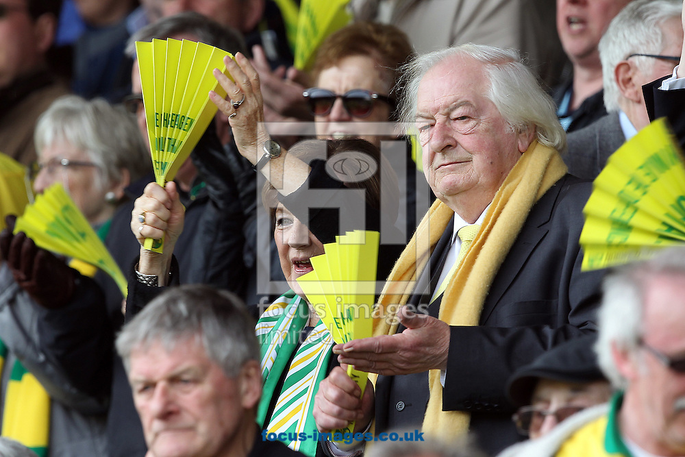 Norwich City's Joint Majority Shareholders, Delia Smith and her husband Michael Wynn-Jones join in with the clappers before the Barclays Premier League match at Carrow Road, Norwich<br /> Picture by Paul Chesterton/Focus Images Ltd +44 7904 640267<br /> 02/04/2016