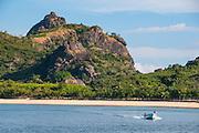 Little motorboat cruising before, Naviti island, Yasawas, Fiji, South Pacific