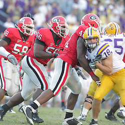 25 October 2008:  Georgia players Marcus Washington (44), Geno Atkins (56) and Bo Fowler (59) in action during the Georgia Bulldogs 52-38 victory over the LSU Tigers at Tiger Stadium in Baton Rouge, LA.