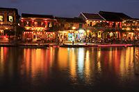 Looking across the Thu Bon river to Bach Dang Street in Hoi An, Vietnam