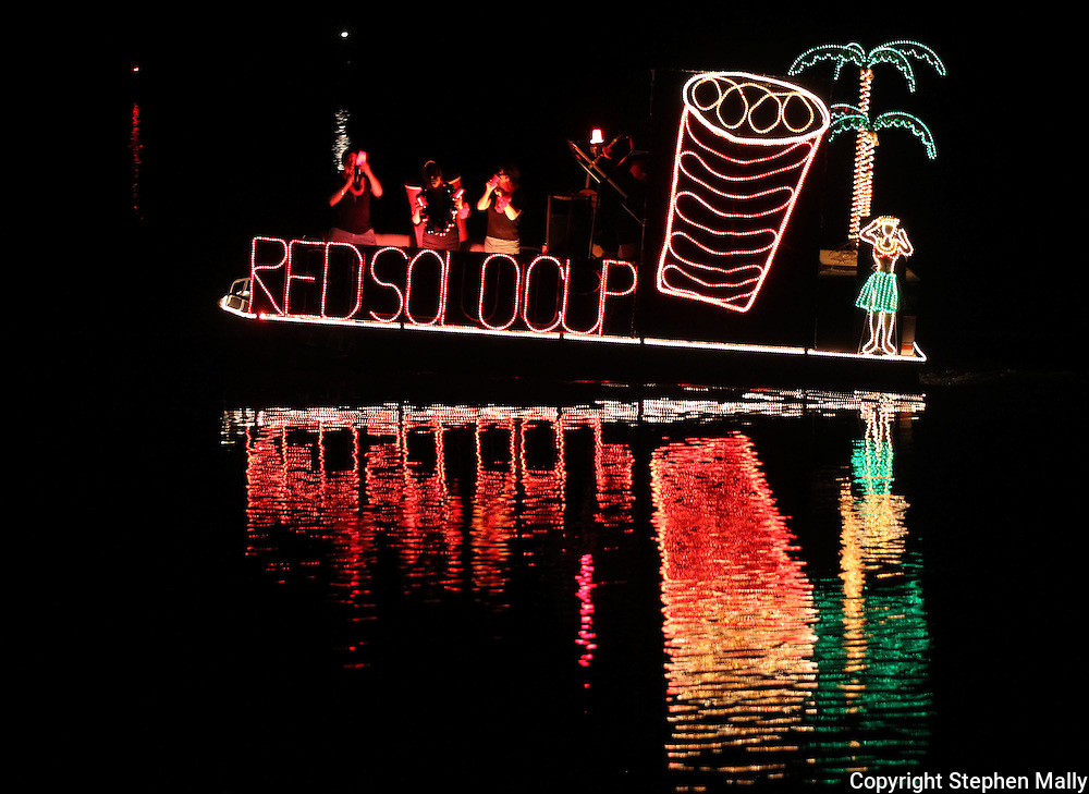 A boat featuring a red Solo cup makes it's way up stream during the Cedar Boat Club Venetian Nights Lighted Boat Parade and Fireworks along the Cedar River on Saturday evening, August 18, 2012.