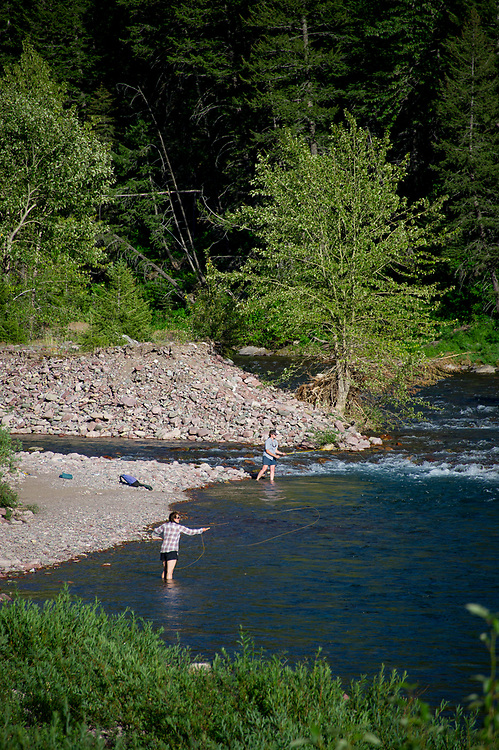 U.S. Forest Service employees in the Great Bear Wilderness mapping vegetation fishing for their dinner in the middle fork of the Flathead River near Granite Cabin.
