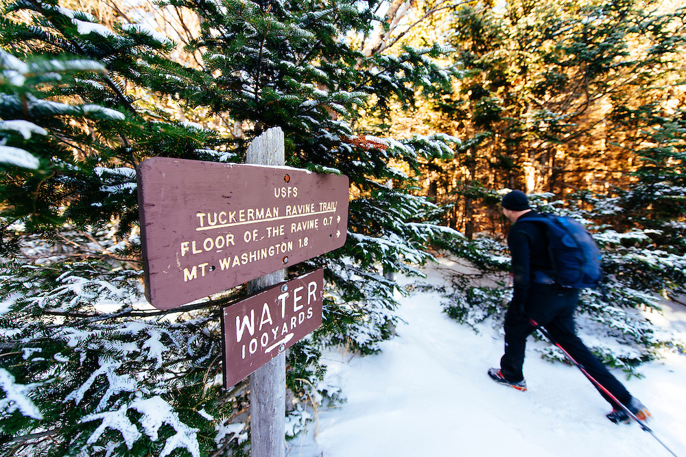 Craig hiking by the Tuckerman Ravine Trail sign after leaving the Hermit Lake shelter.