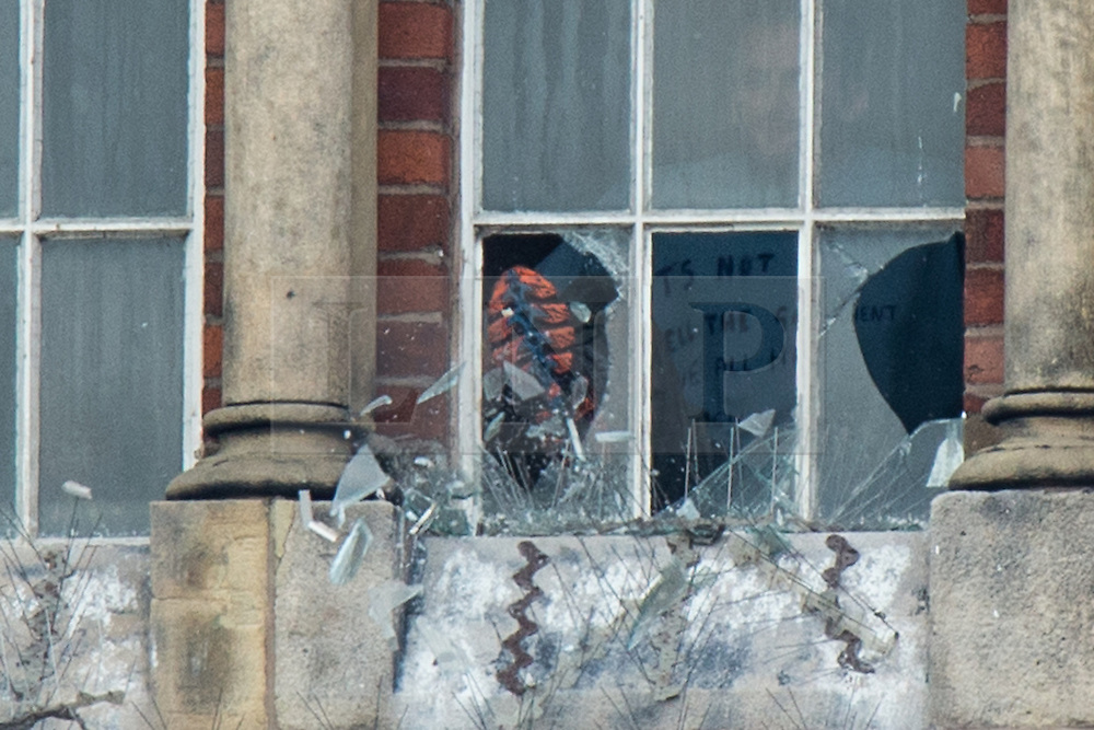 © Licensed to London News Pictures . 15/09/2015 . Manchester , UK . STUART HORNER kicks through windows from inside the rotunda on the roof at HMP Manchester (formerly Strangeways Prison ), this morning (15th September 2015) . Photo credit : Joel Goodman/LNP