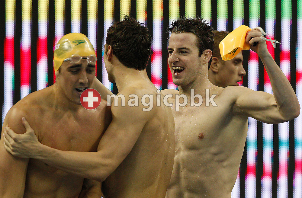 (L-R) Matthew ABOOD, Matthew TARGETT and James MAGNUSSEN of Australia celebrate after their teammate Eamon SULLIVAN (not pictured) touched first in the men's 4x100m Freestyle Relay Final during the 14th FINA World Aquatics Championships at the Oriental Sports Center in Shanghai, China, Sunday, July 24, 2011. (Photo by Patrick B. Kraemer / MAGICPBK)