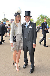 The HON.EDWARD SACKVILLE and his wife SOPHIE at the first day of the 2014 Royal Ascot Racing Festival, Ascot Racecourse, Ascot, Berkshire on 17th June 2014.